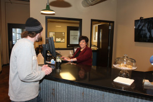 Stacy, one of our owners, greeting people at our reception counter